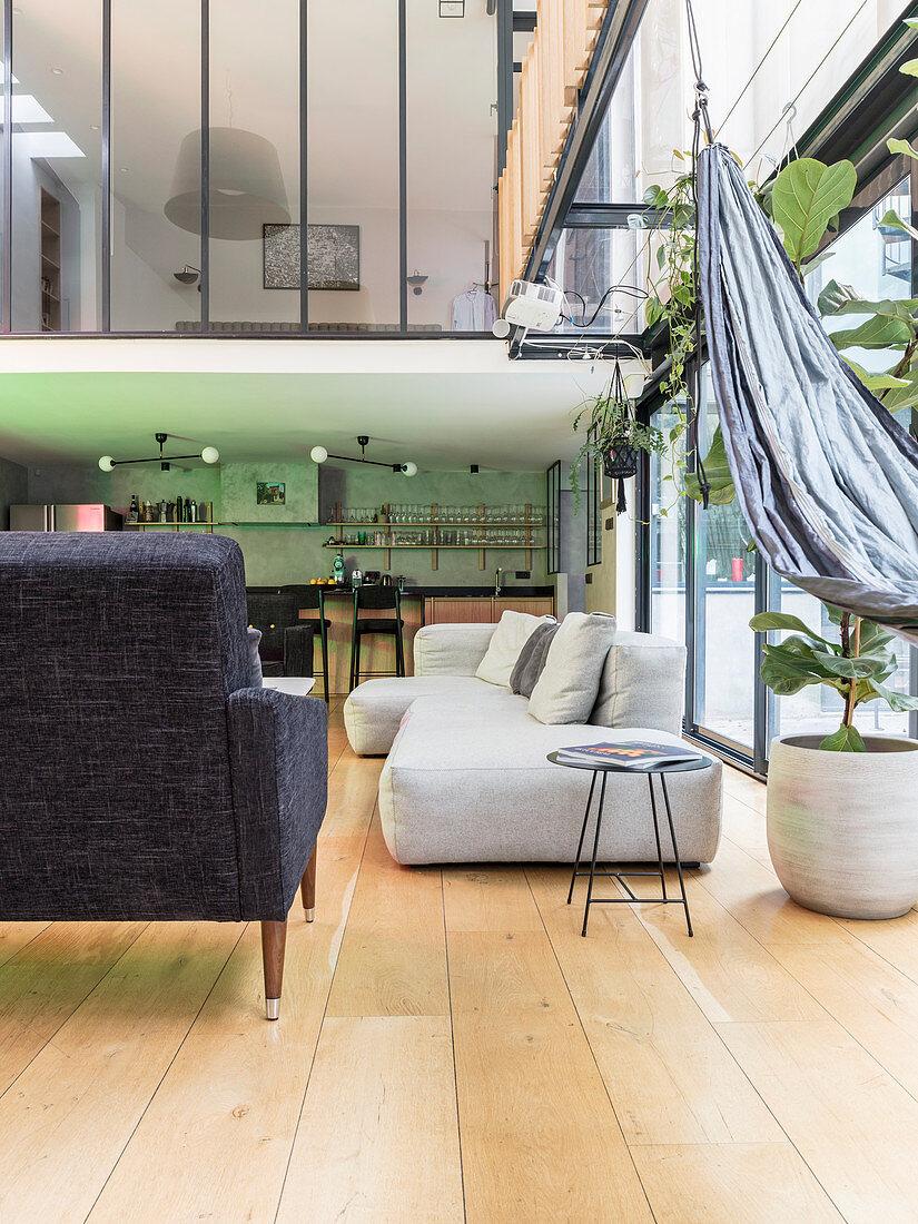 Pale sofa next to terrace doors in loft apartment