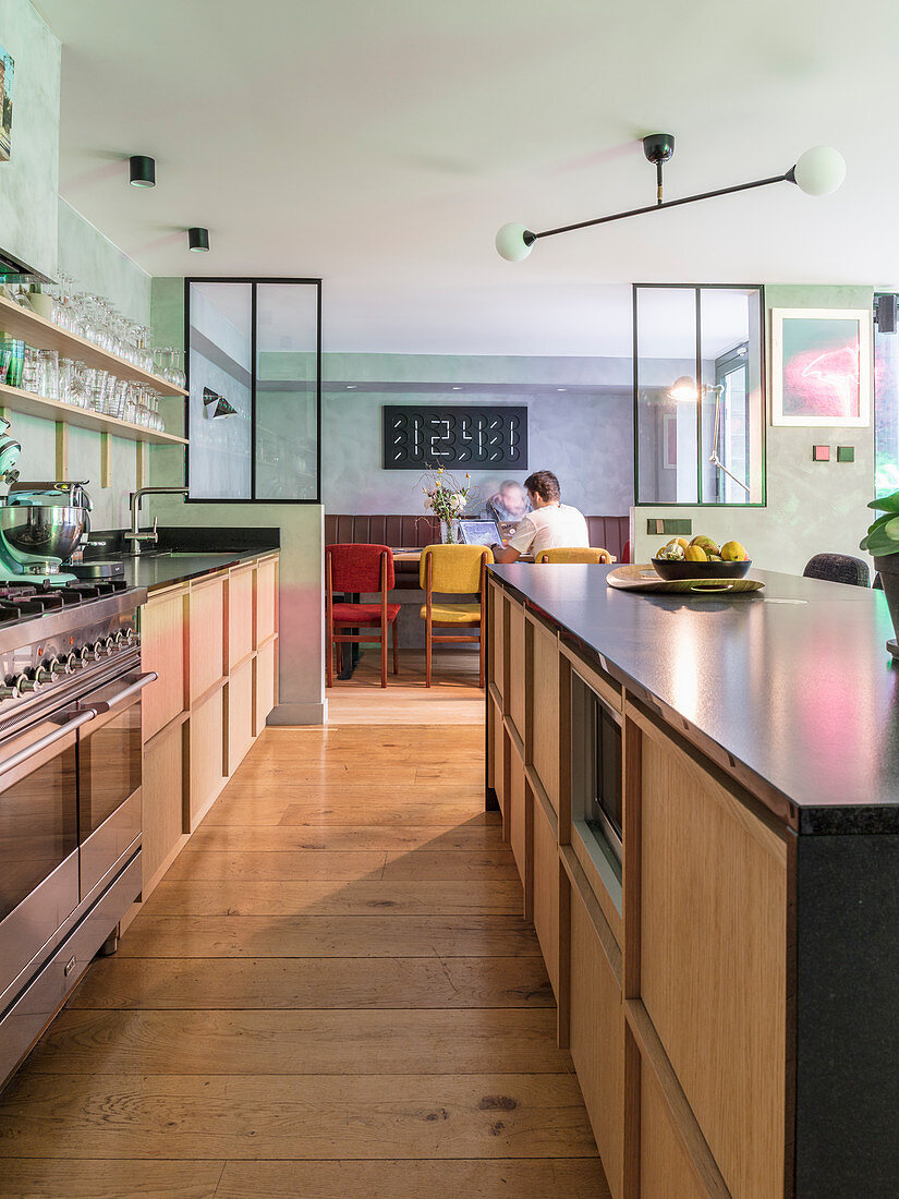 Kitchen with island counter and separate dining area in background
