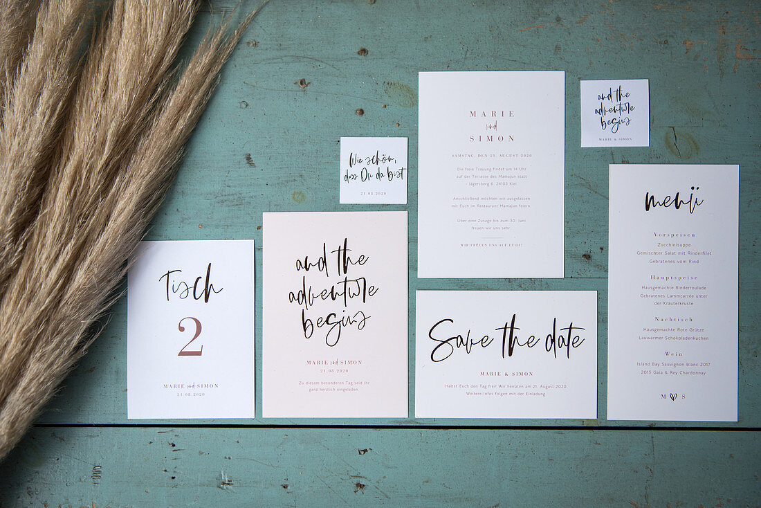 Various wedding cards on blue surface