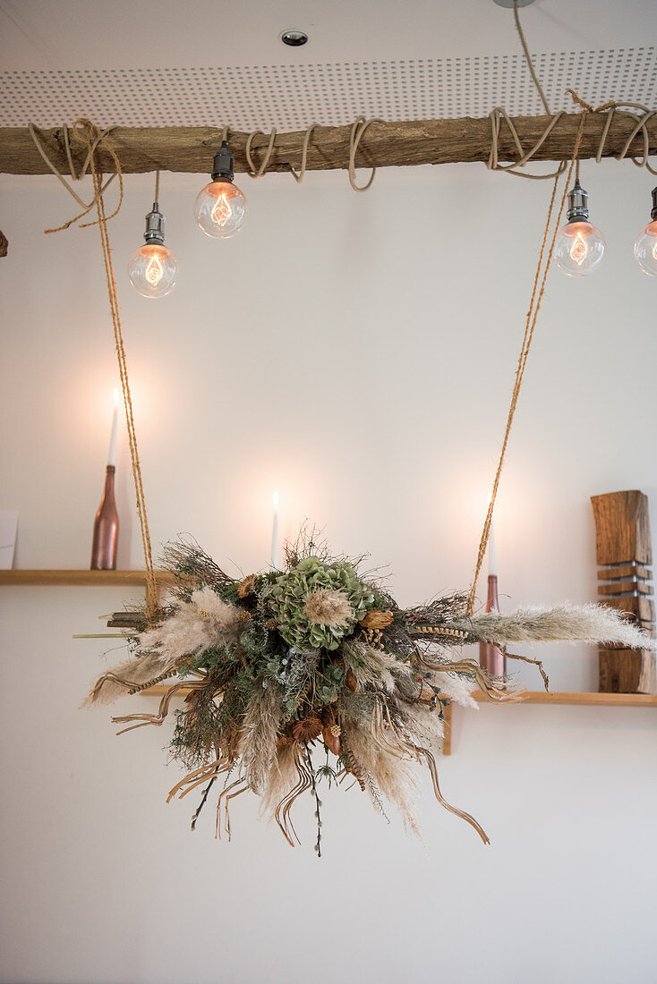 Arrangement of dried flowers suspended over table