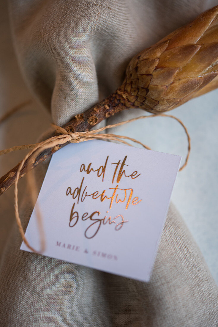 Card with motto on wedding table