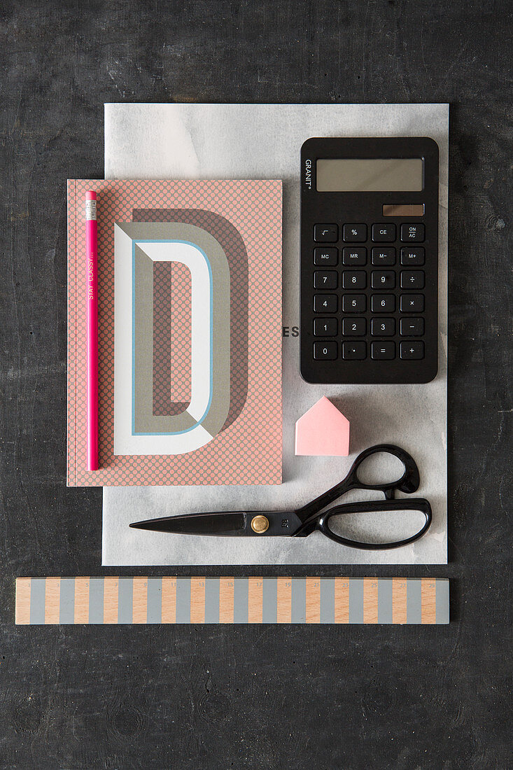Notebook, calculator and scissors