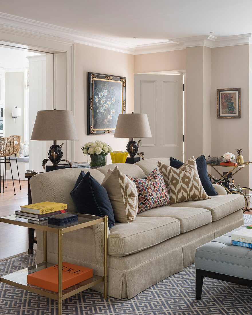 Beige sofa in classic living room with stucco elements