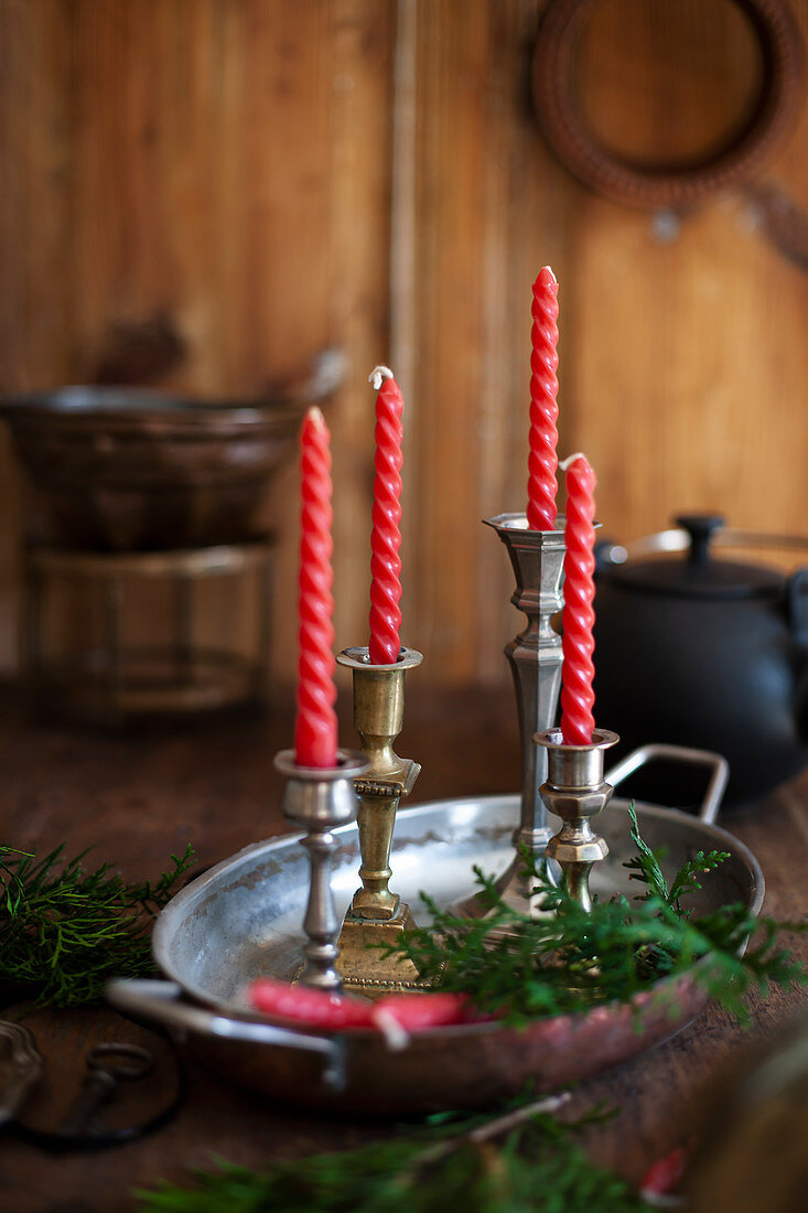 Antique candle holders with red candles