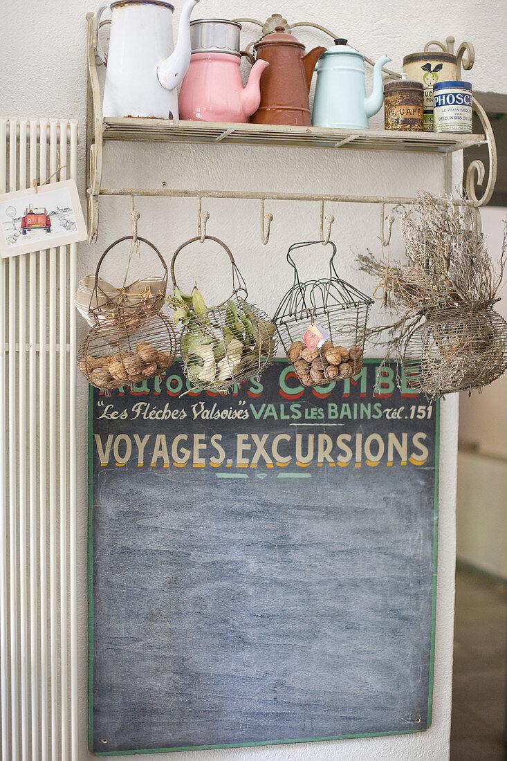 Old enamel pots on a shelf with wire baskets
