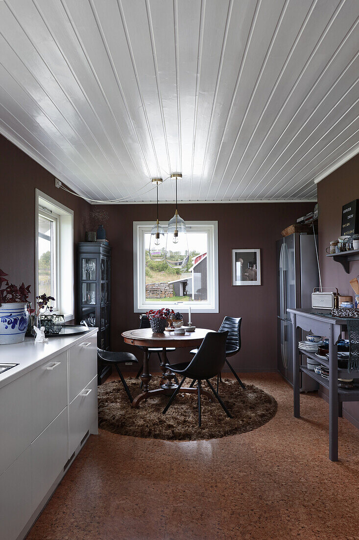 View of dining area in kitchen with dark walls