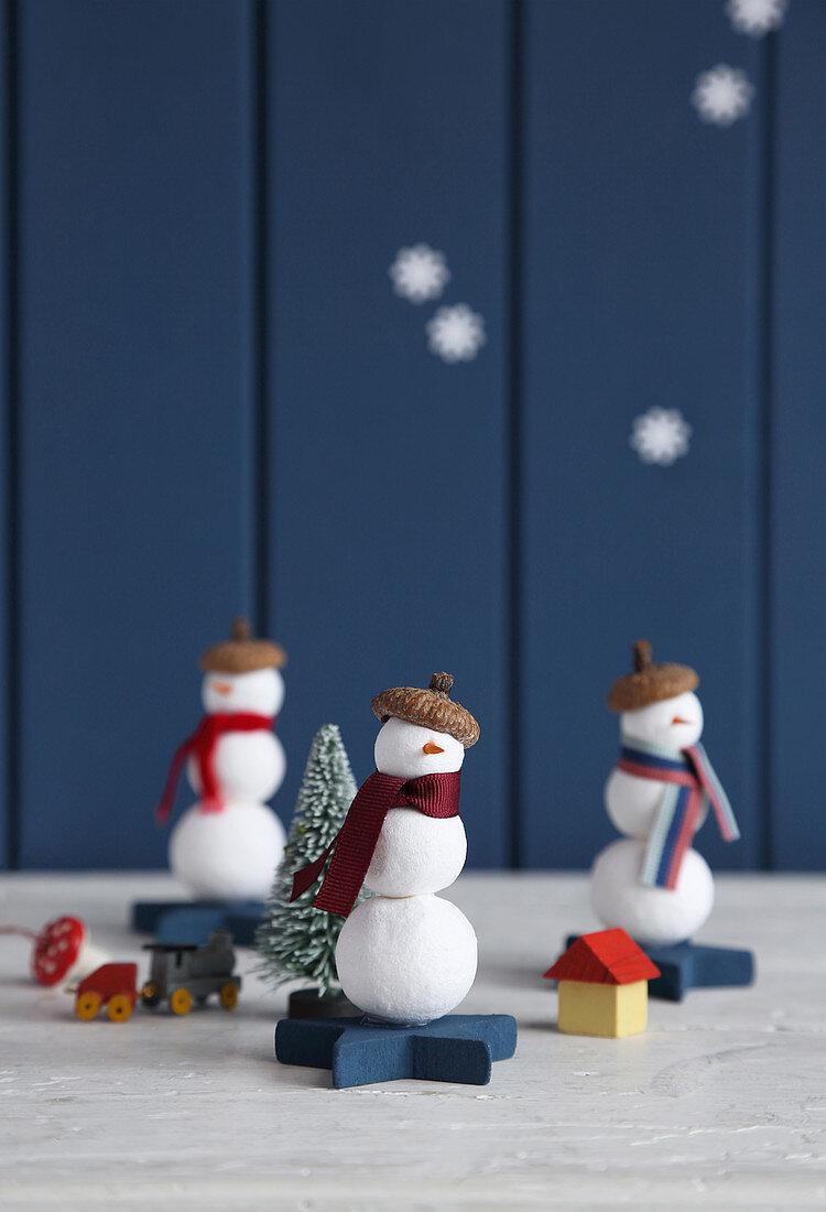 Snowman decorations handmade from cotton wool balls