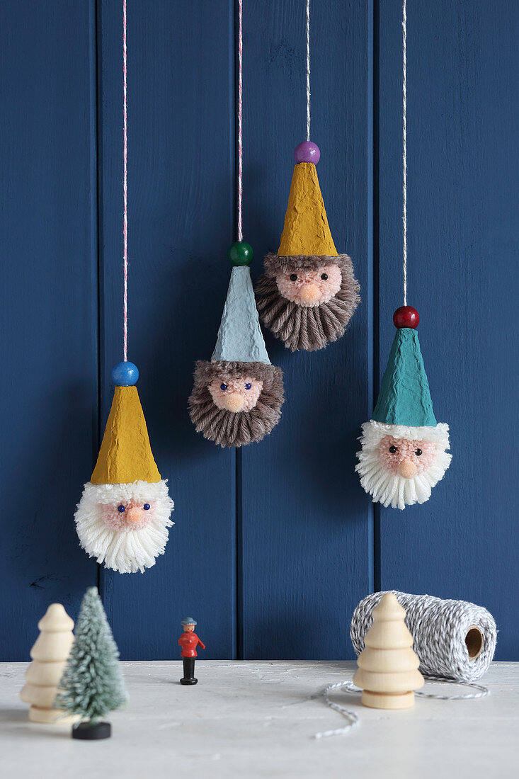 Suspended gnome decorations handmade from egg boxes and wool