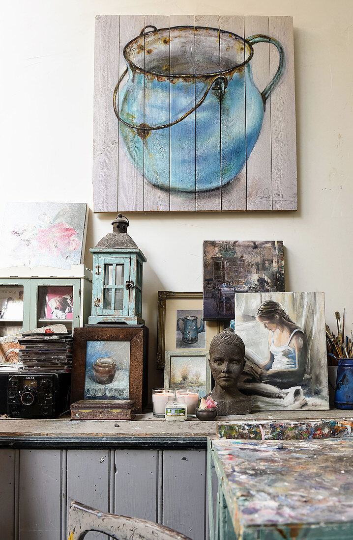 Picture of old jug painted on boards above sideboard in artist's studio