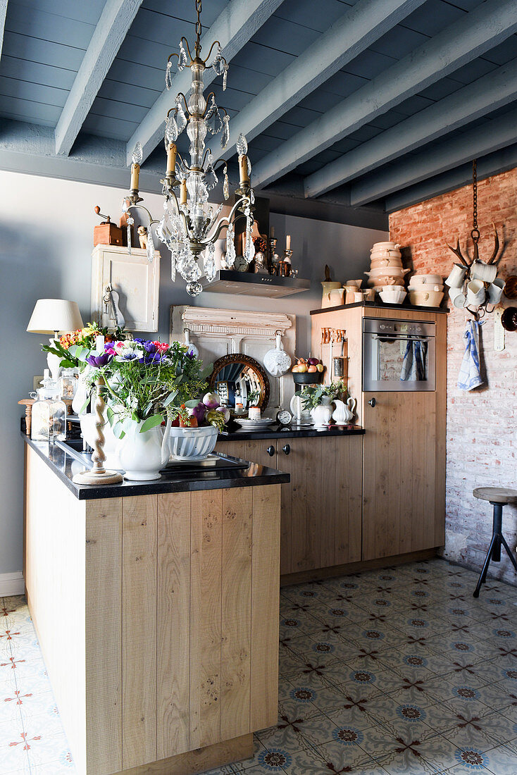 Rustic kitchen in Mediterranean vintage style with grey beamed ceiling