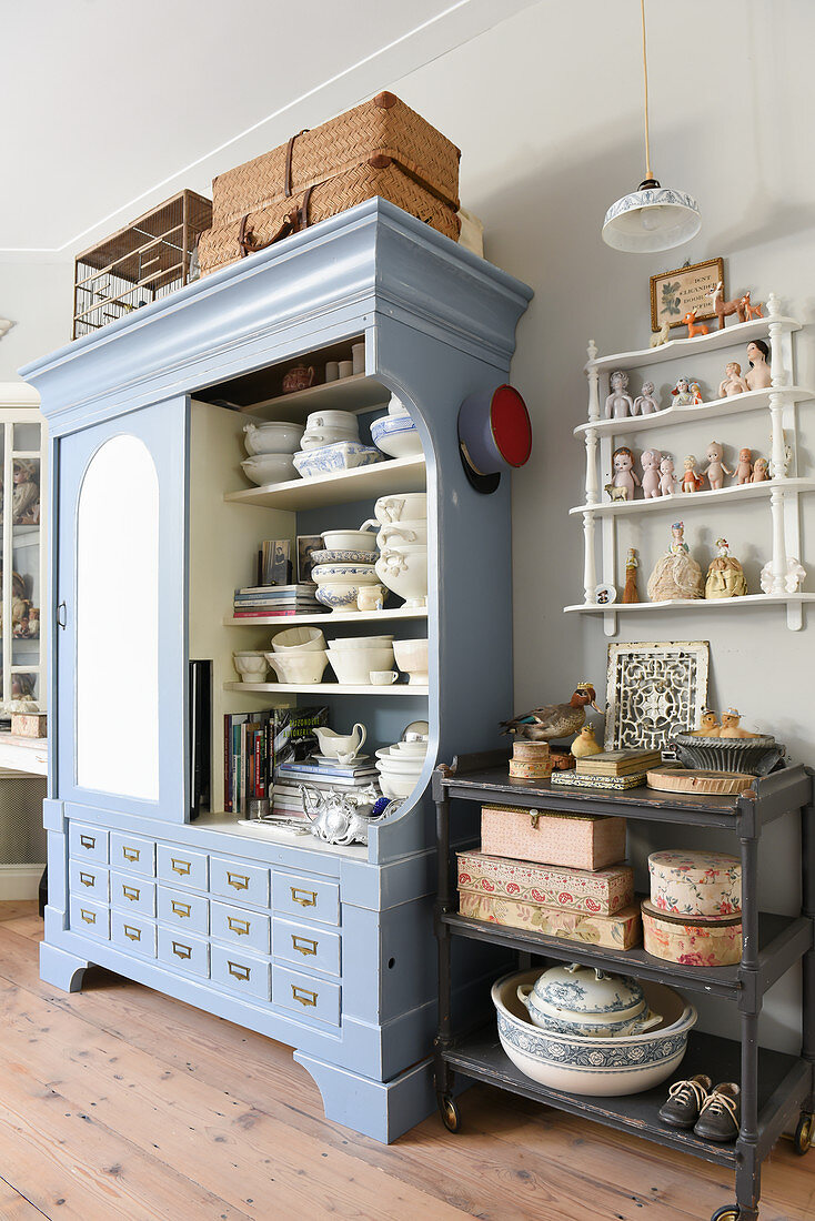 Crockery in open-fronted dresser and vintage accessories