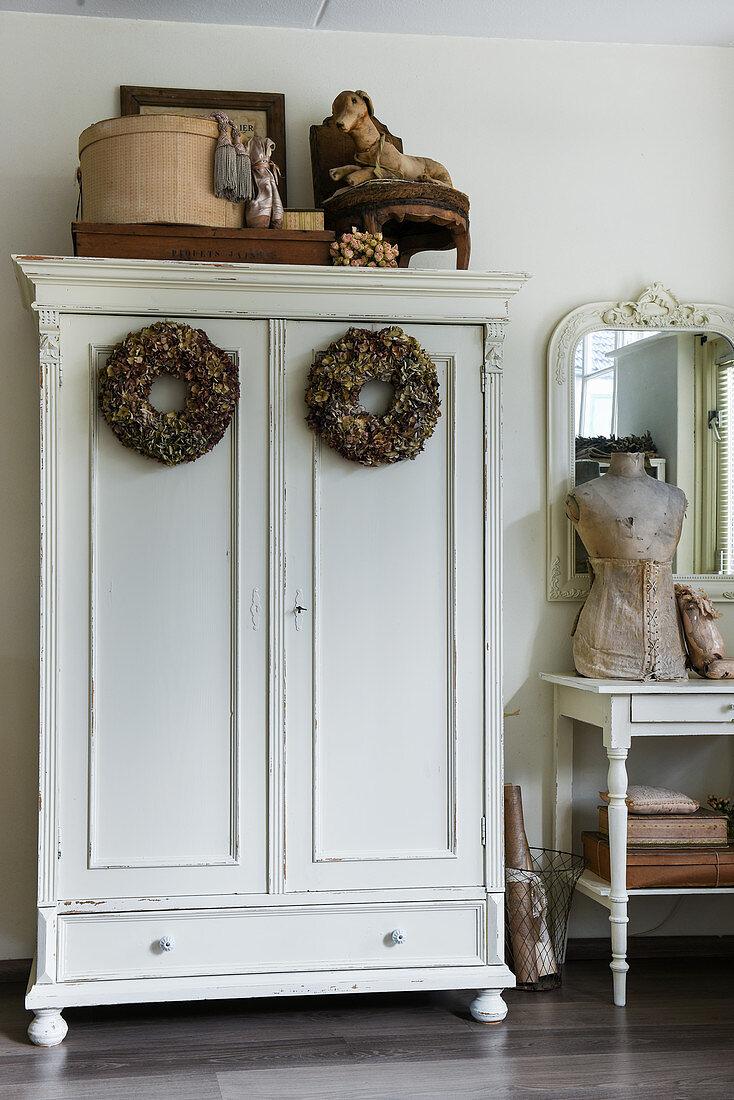 Two wreaths of dried hydrangeas on doors of old wardrobe