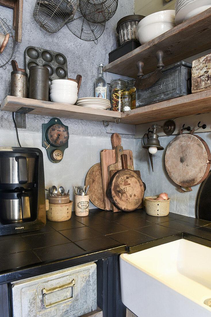 Old kitchen utensils on shelves of vintage-style kitchen