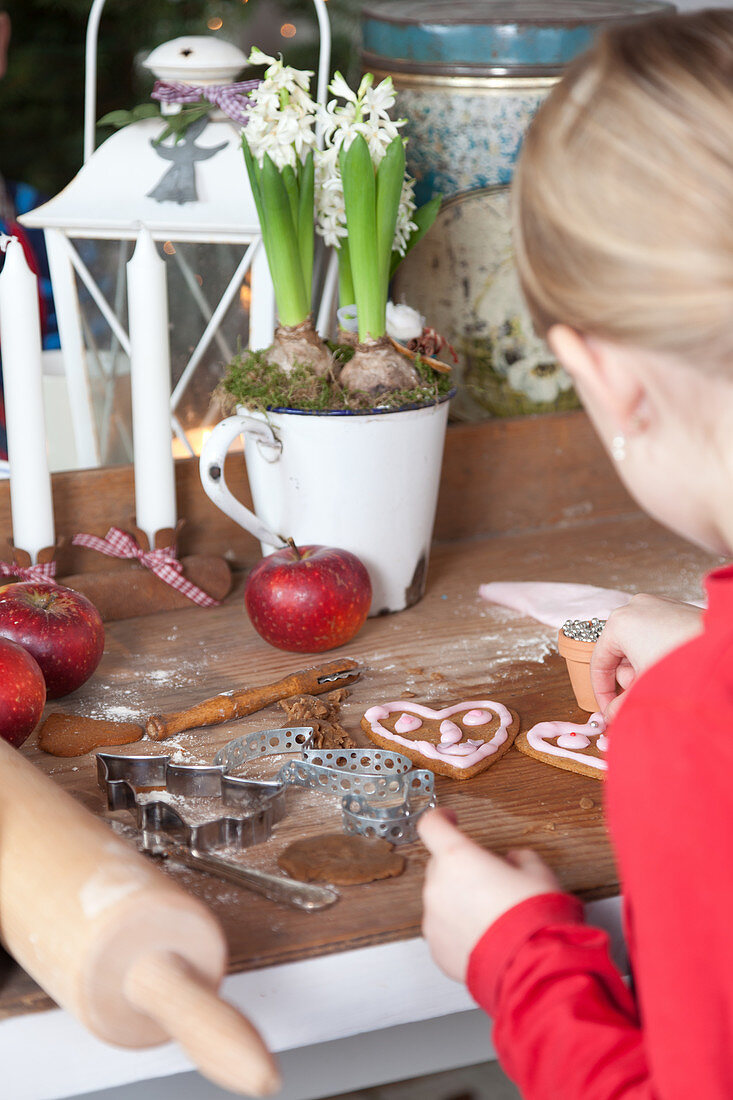 Girl decorating gingerbread cookies