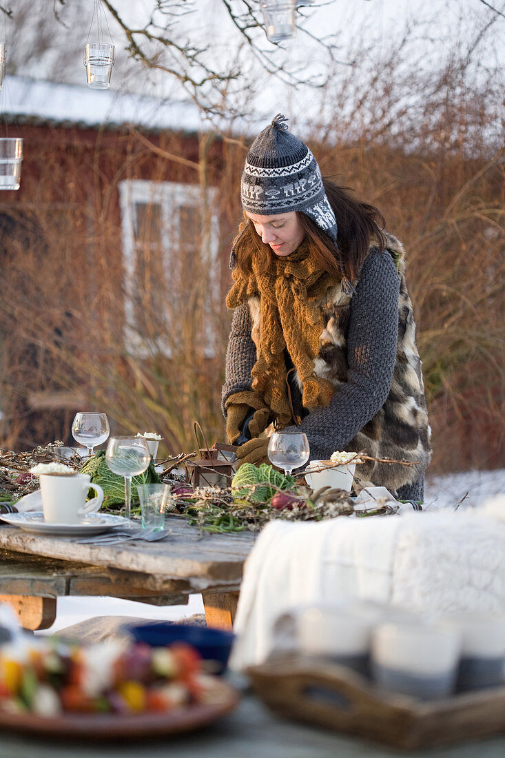A woman decorating a table in the garden