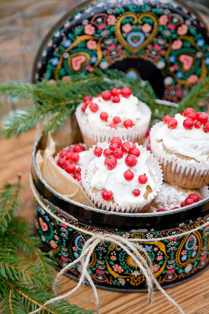 Gingerbread muffins with cream-cheese frosting and redcurrants