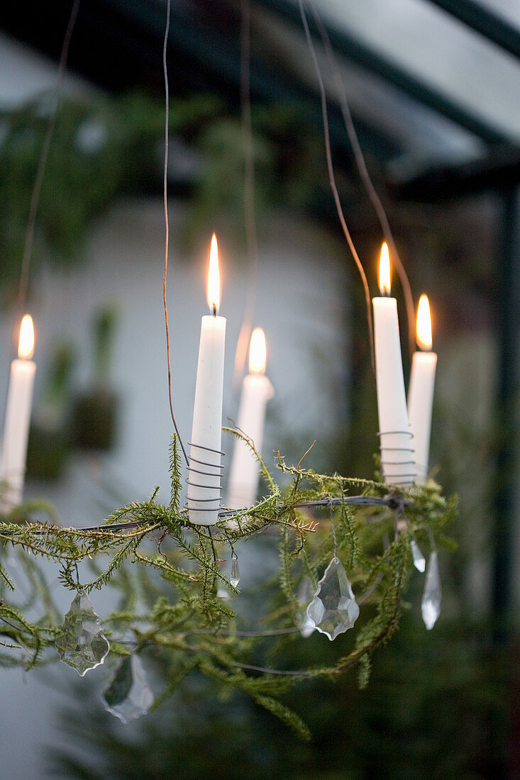 Suspended wreath decorated with glass beads and candles
