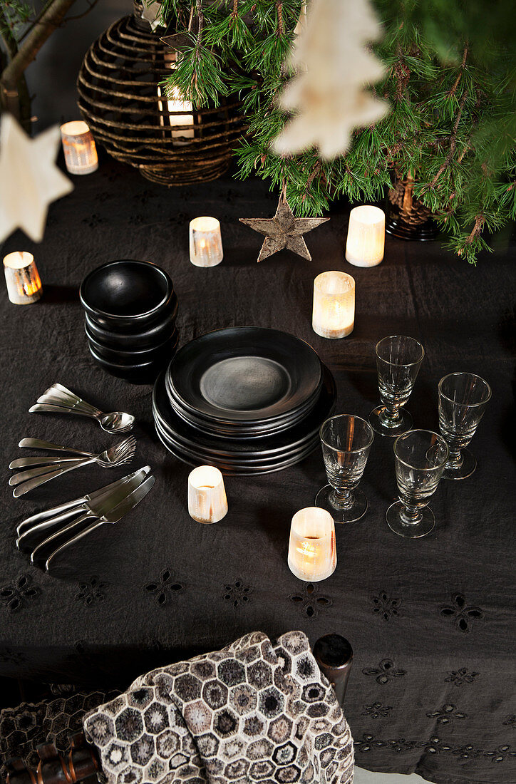 Crockery and candle lanterns on Christmas table