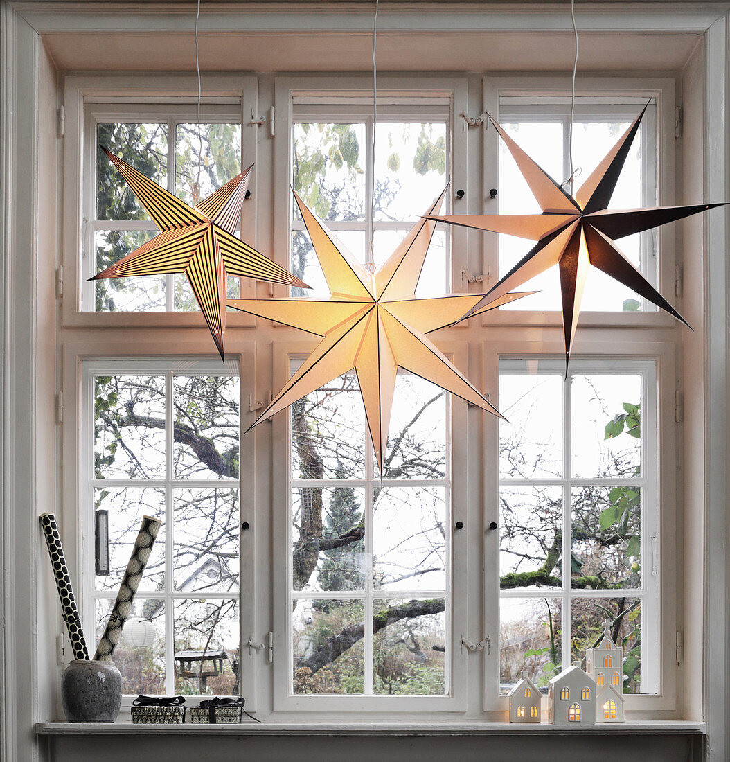Paper Christmas stars in window