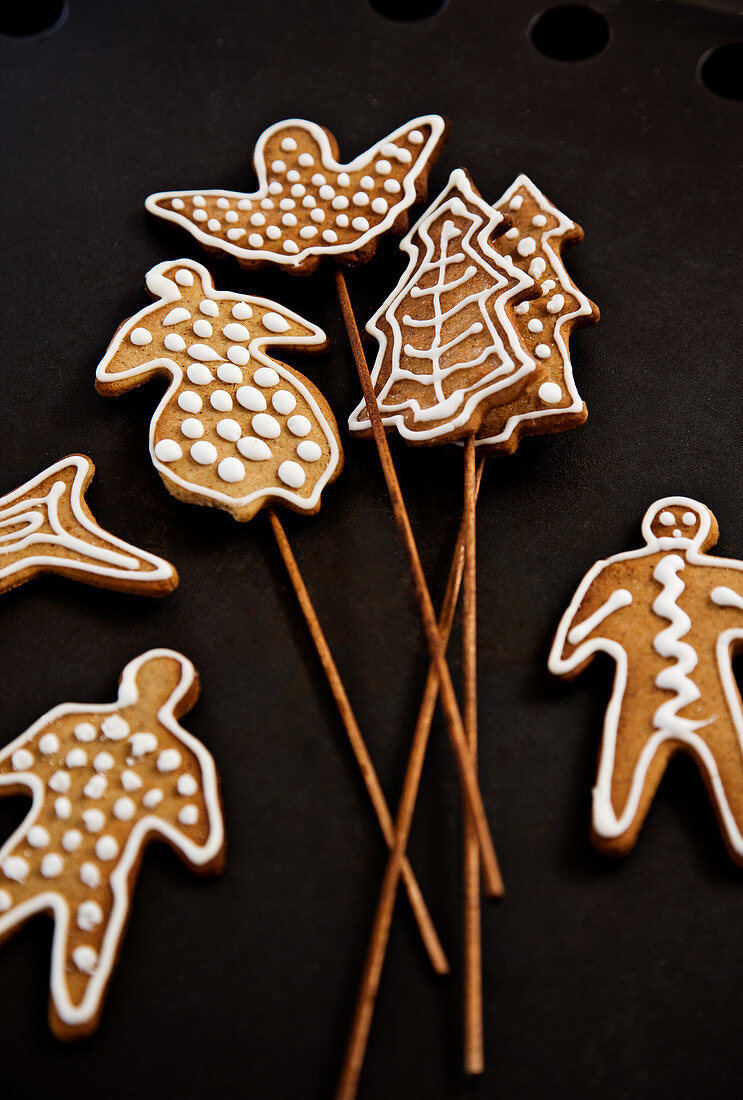 Decorated gingerbread shapes on wooden skewers