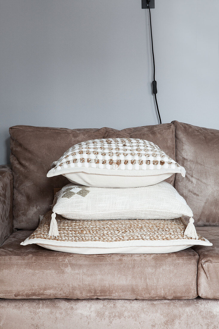 Scatter cushions on sand-coloured sofa