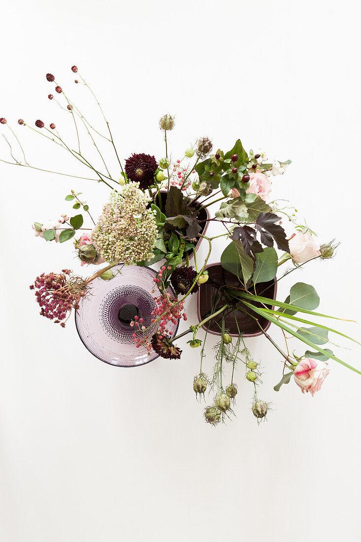 Autumn flowers: roses, eucalyptus, love-in-a-mist seed heads, great burnet, sedum, pink pepper and chrysanthemums