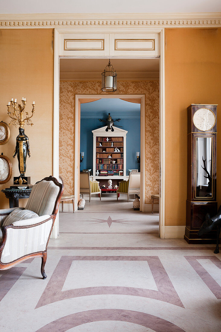 Connecting rooms with marble floors and aligned open doorways