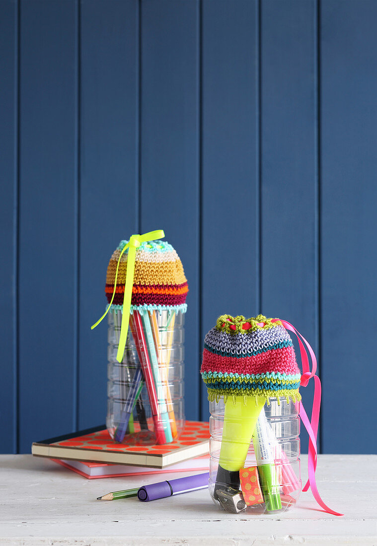 Pen holders made from PET bottles with crocheted covers