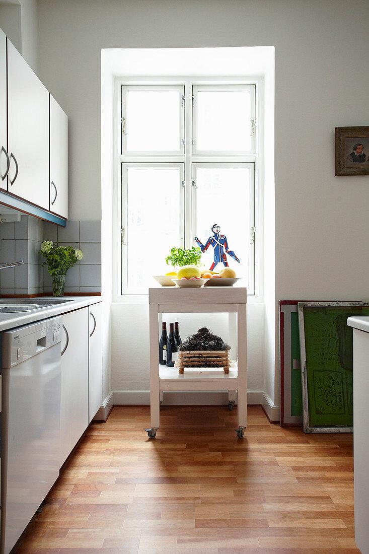 Serving trolley below window in kitchen