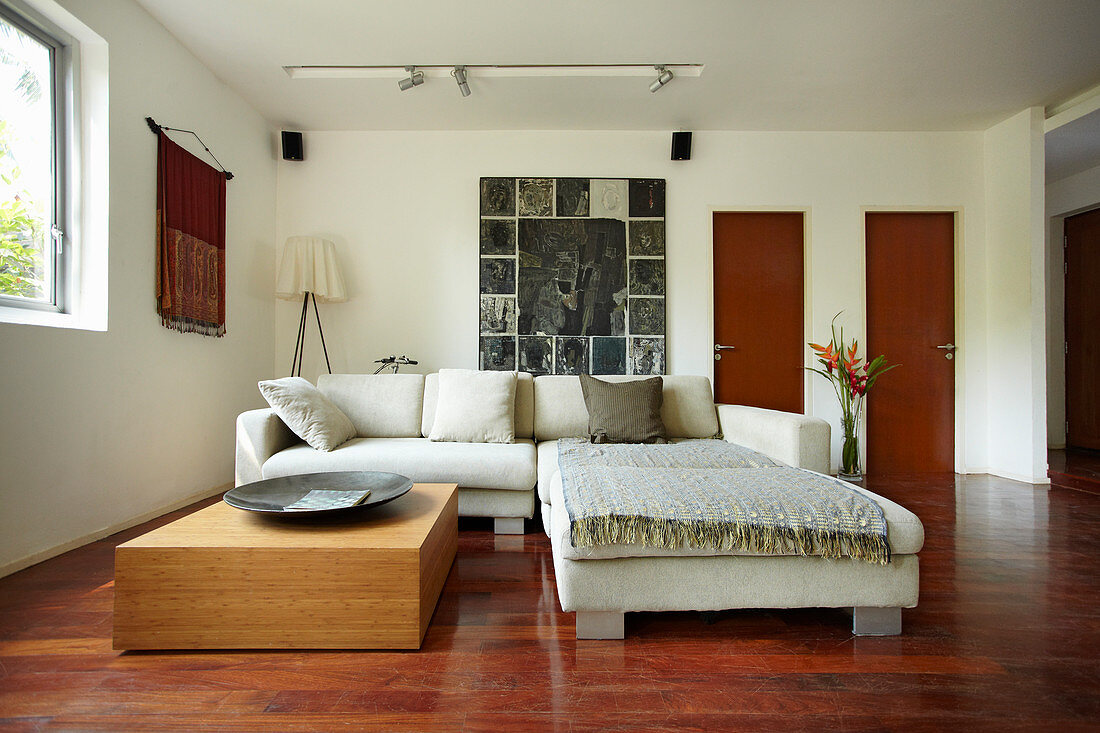 Sofa set and low table in living room with teak floor