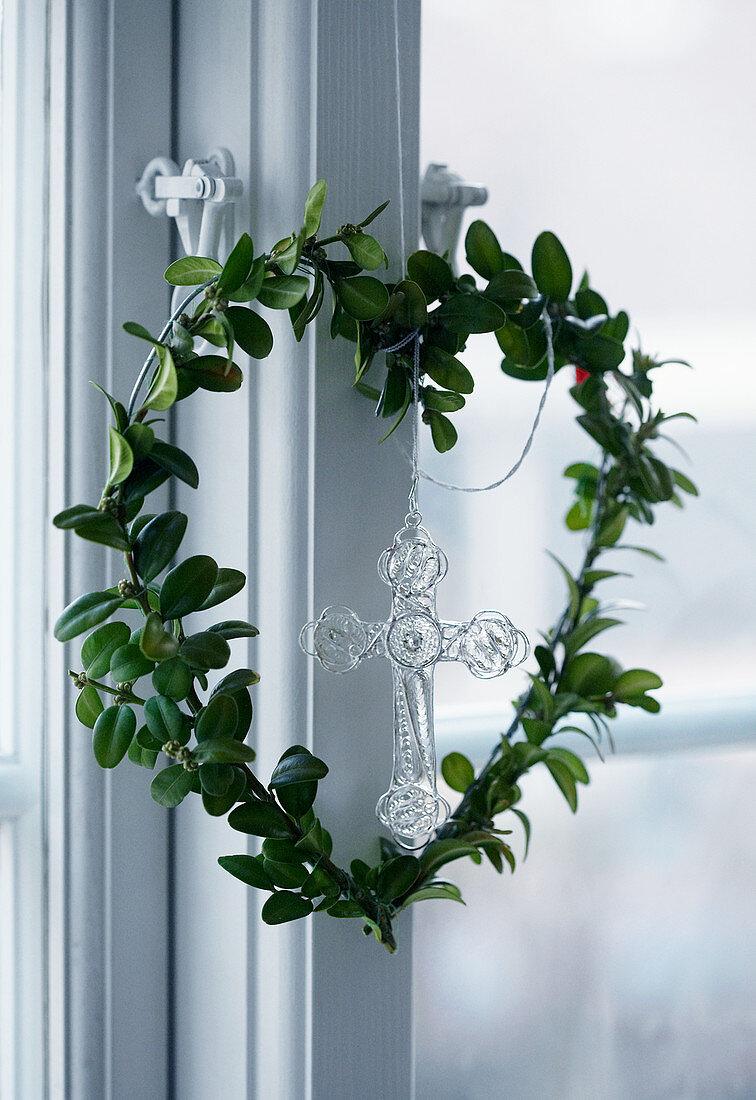 Heart-shaped wreath hanging on window
