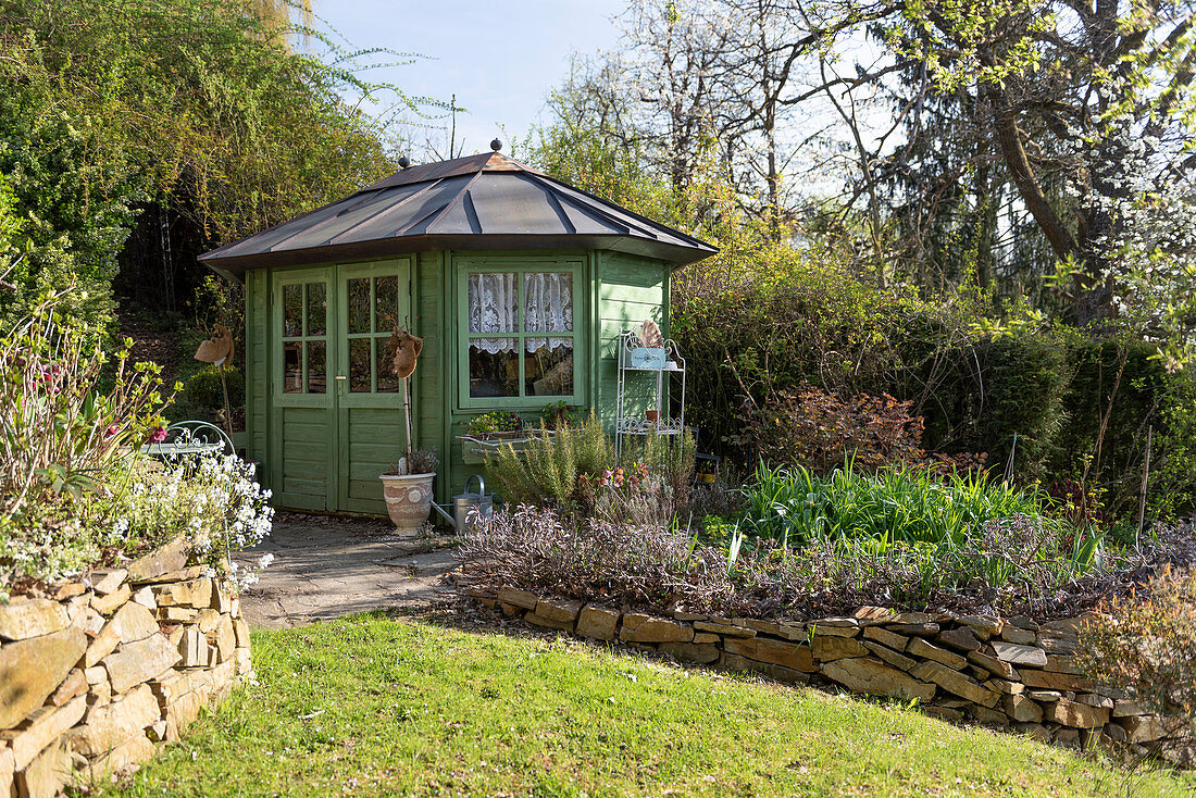 Slope garden with garden shed and dry stone walls