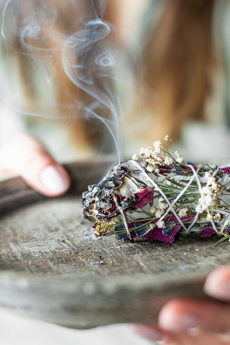 Smudge stick made from twigs and flowers