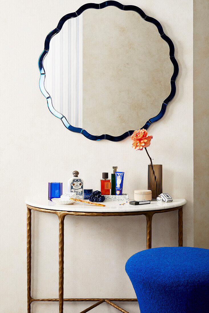 Wall mirror above console table in bathroom