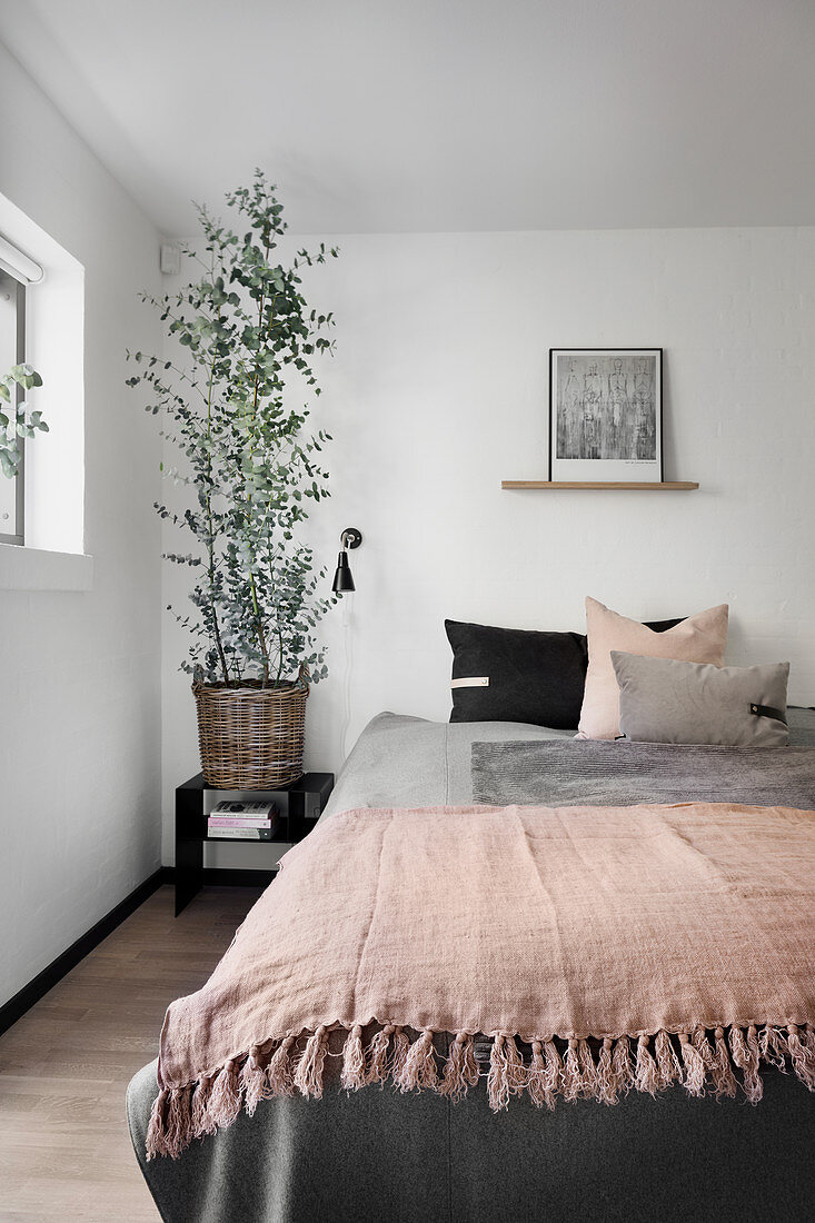 Layers of blankets on bed in simple bedroom