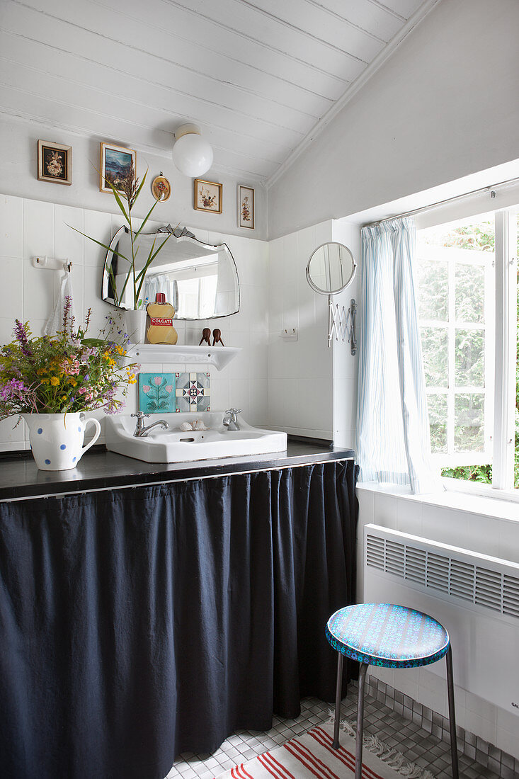 Washstand with dark curtain cover in shabby-chic bathroom