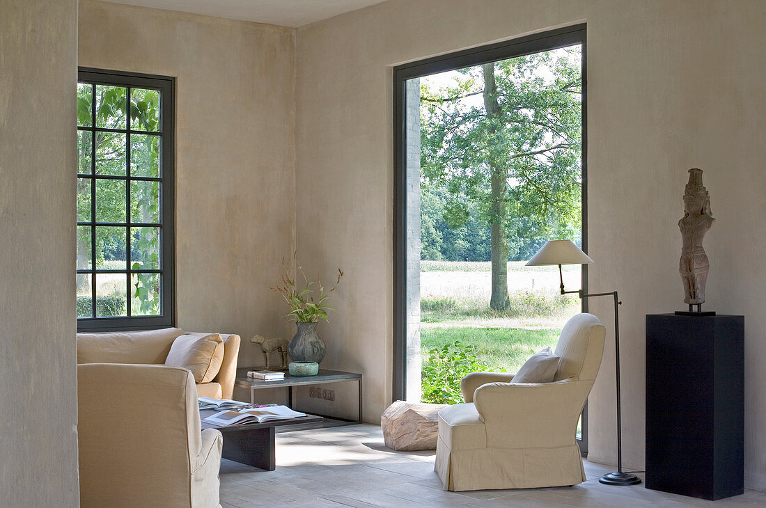 Simple living room with access to garden in country house