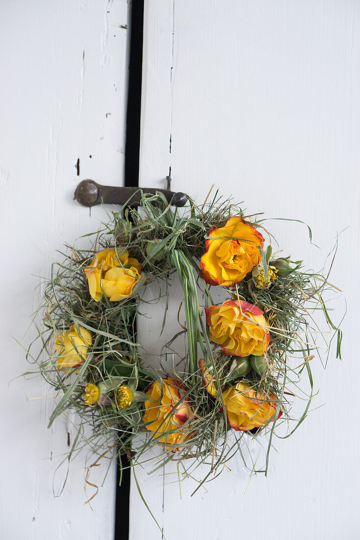 Wreath of rose flowers and grass as a door wreath