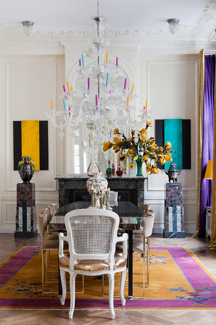 Opulent dining room with brightly coloured accents in period building