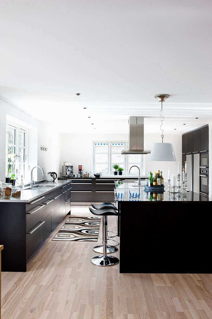 Black fitted cabinets in large modern kitchen