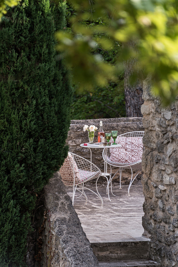 Wire mesh chairs and table on terrace