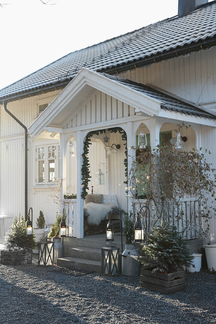 Wooden house with festively decorated porch