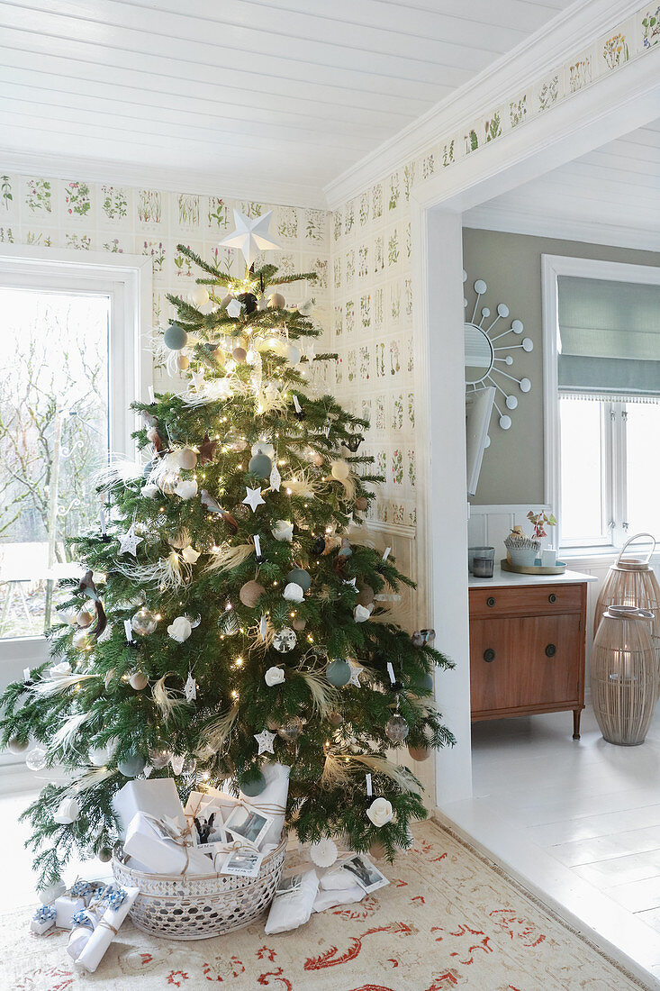 Decorated Christmas tree in rustic living room