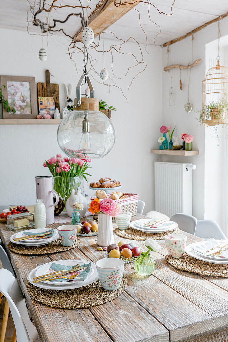 Table set for spring meal in dining room with rustic decorations
