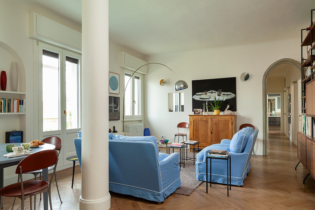 Sofa set with pale blue covers in living room