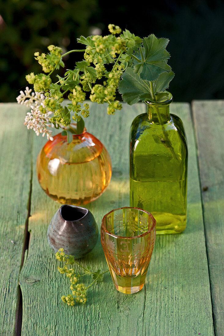 Lady's mantle in glass bottle