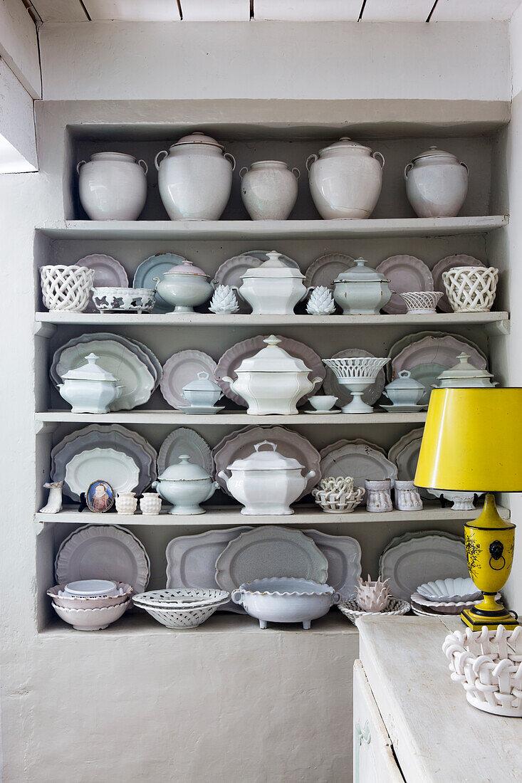 Shelves of white tableware