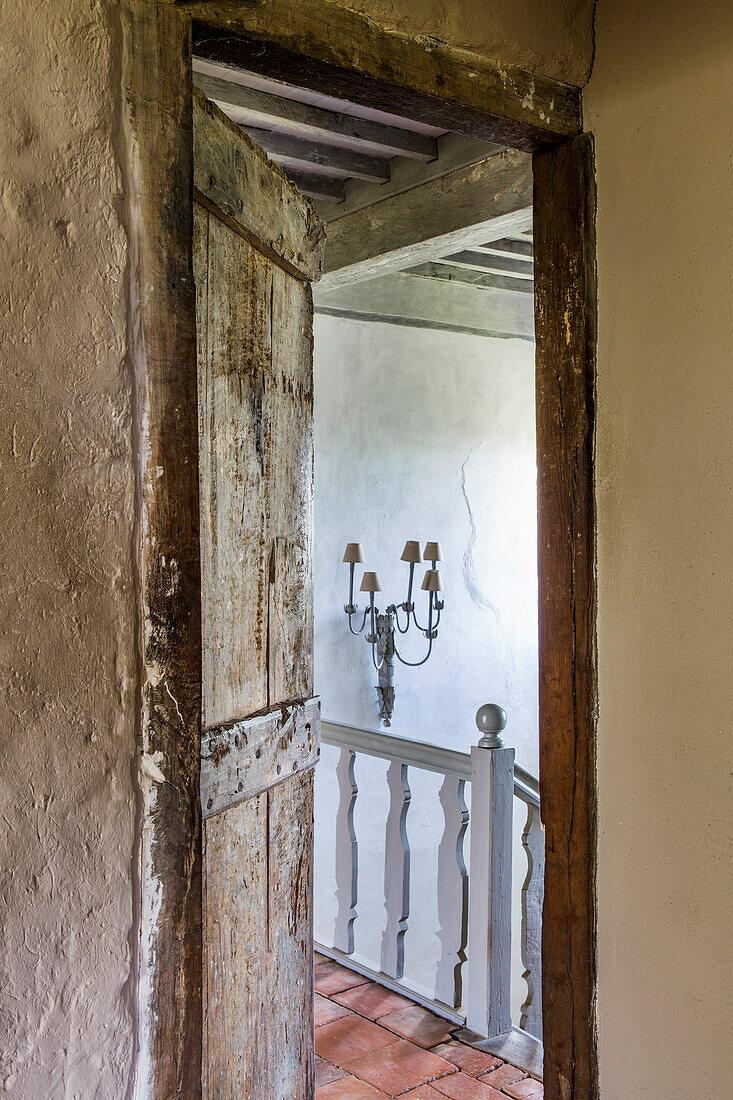 Old wooden door between bedroom and hallway