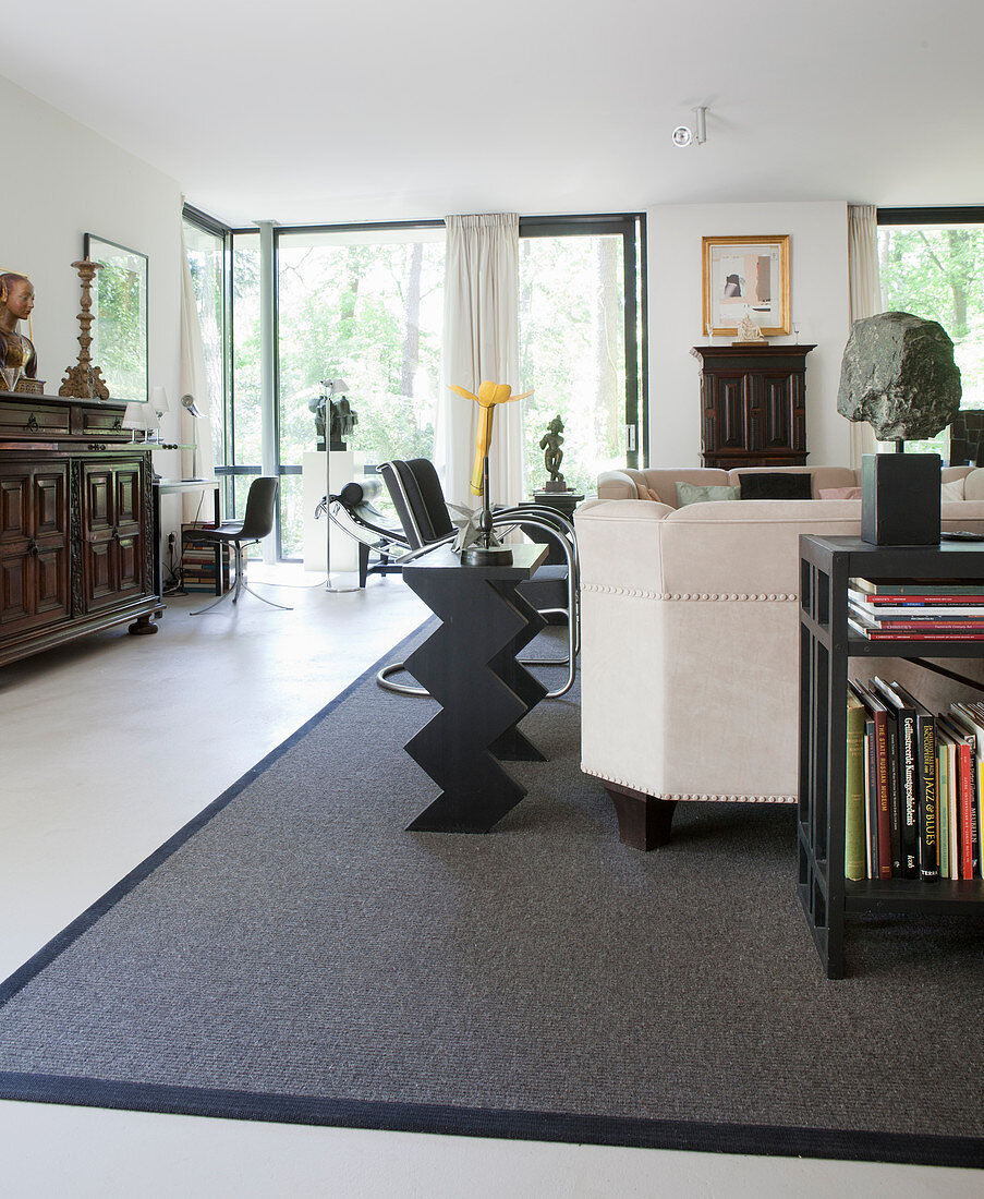Designer furniture, antiques and art collection in living room