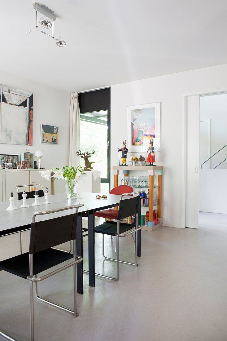 Modern furniture in dining room with white floor